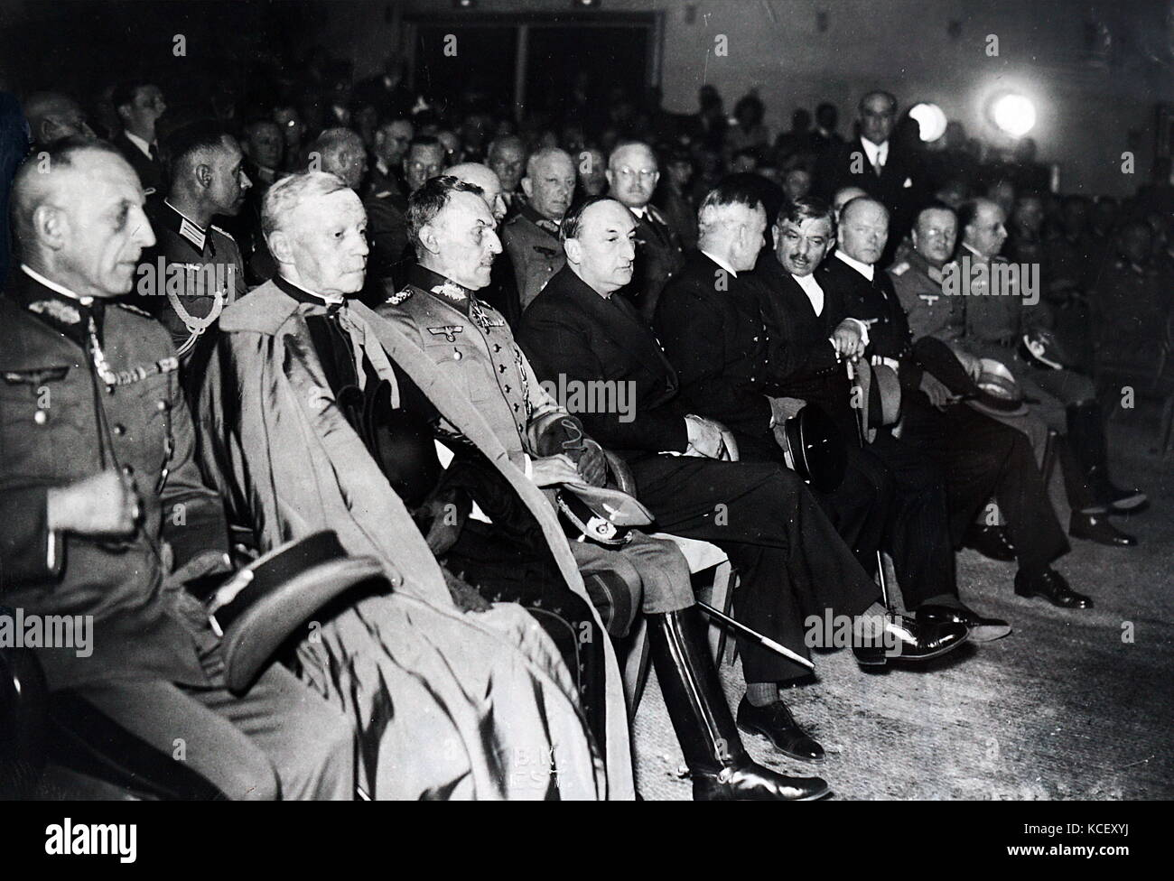 Photograph of Nazi leaders gathered with French leaders for an evening event in Paris. Emmanuel Célestin Suhard, - Stock Image