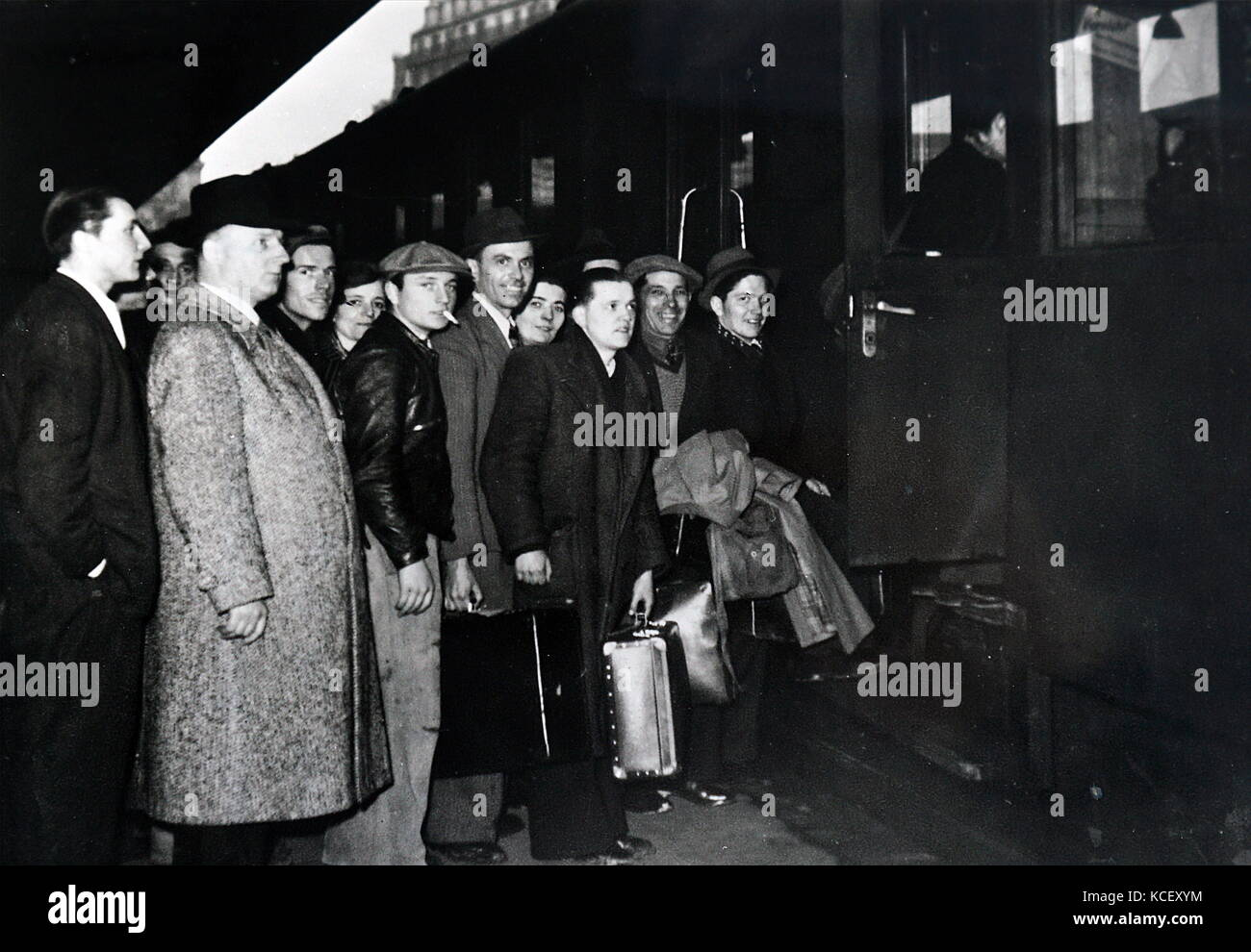 Photograph of young French men travelling by train to enlist in the military during the invasion of France in World - Stock Image