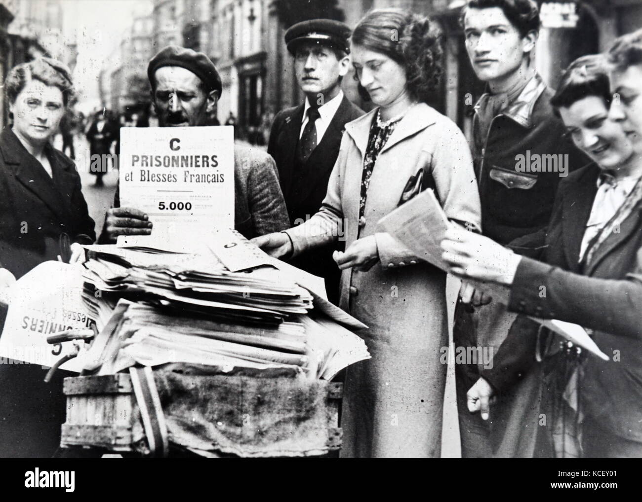 Photograph of the lists of prisoners of war being distributed in Paris , after the invasion of France in World War - Stock Image