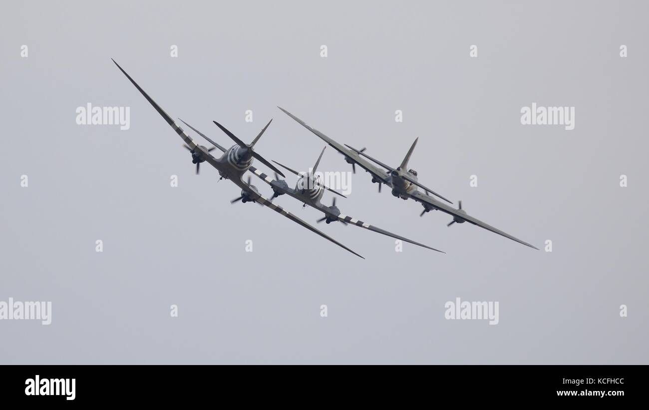 Boeing b-17 Flying Fortress and two Douglas C-47 Skytrain aircraft flying in formation at Duxford 2017 Battle of - Stock Image