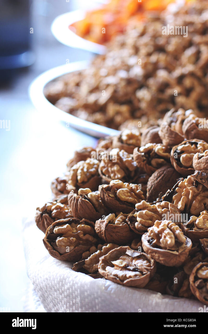Chopped walnuts and dried fruits in bags at east bazar - Stock Image