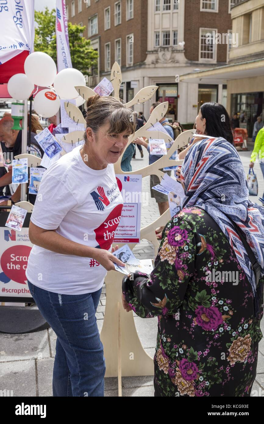 Nurses manning the Scrap the Cap RCN stand  in Exeter  July 17 - Stock Image