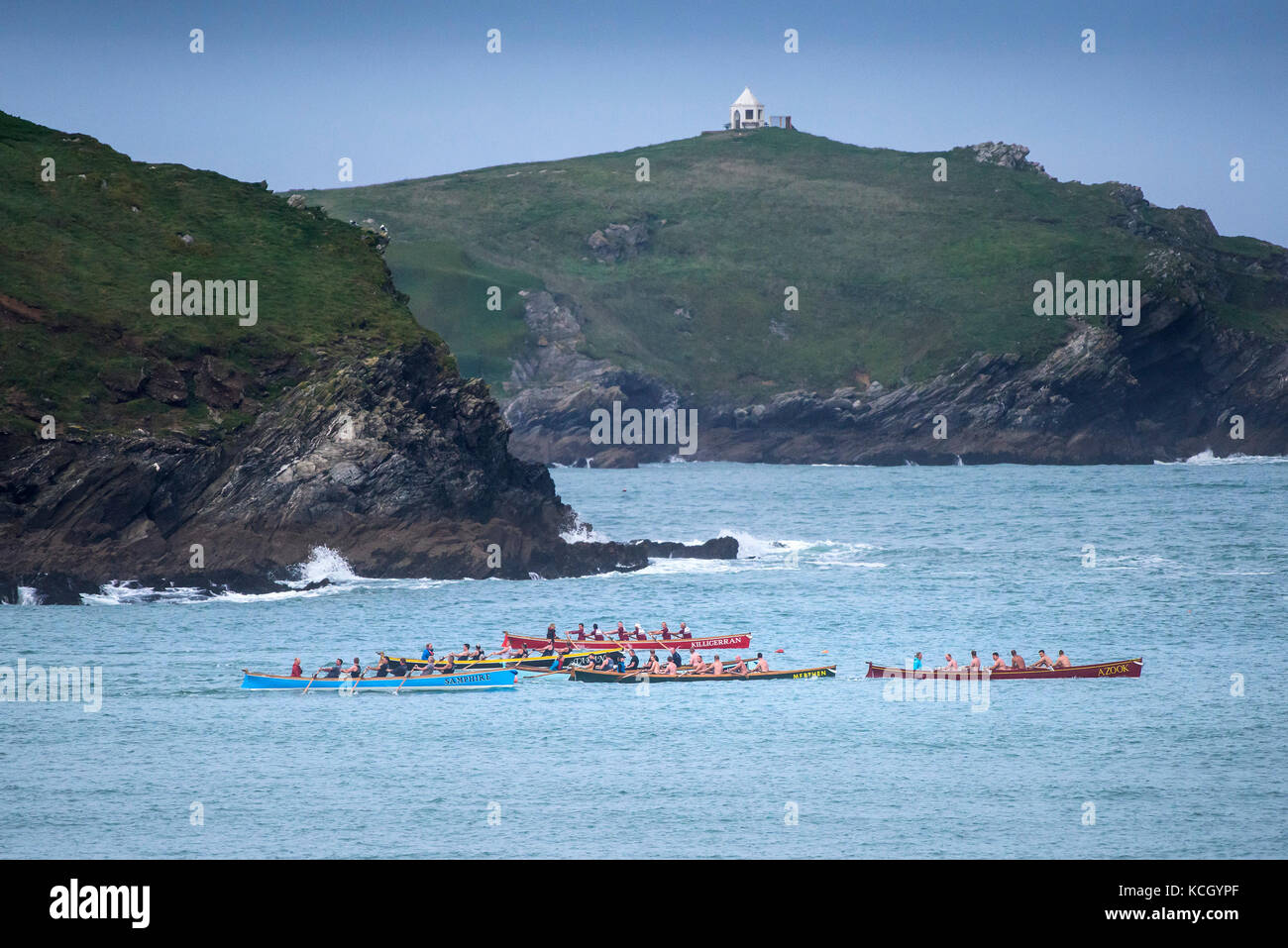Gig racing - traditional Cornish Pilot Gigs racing off the coast of Newquay in Cornwall. - Stock Image