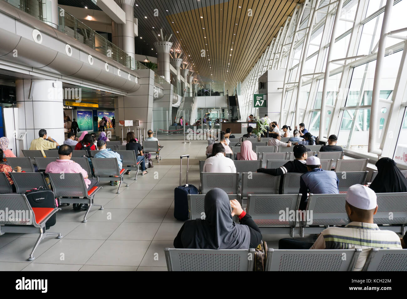 Kota Kinabalu, Malaysia - September 06, 2017: Traveler waiting to board at the departure lounge in Kota Kinabalu - Stock Image