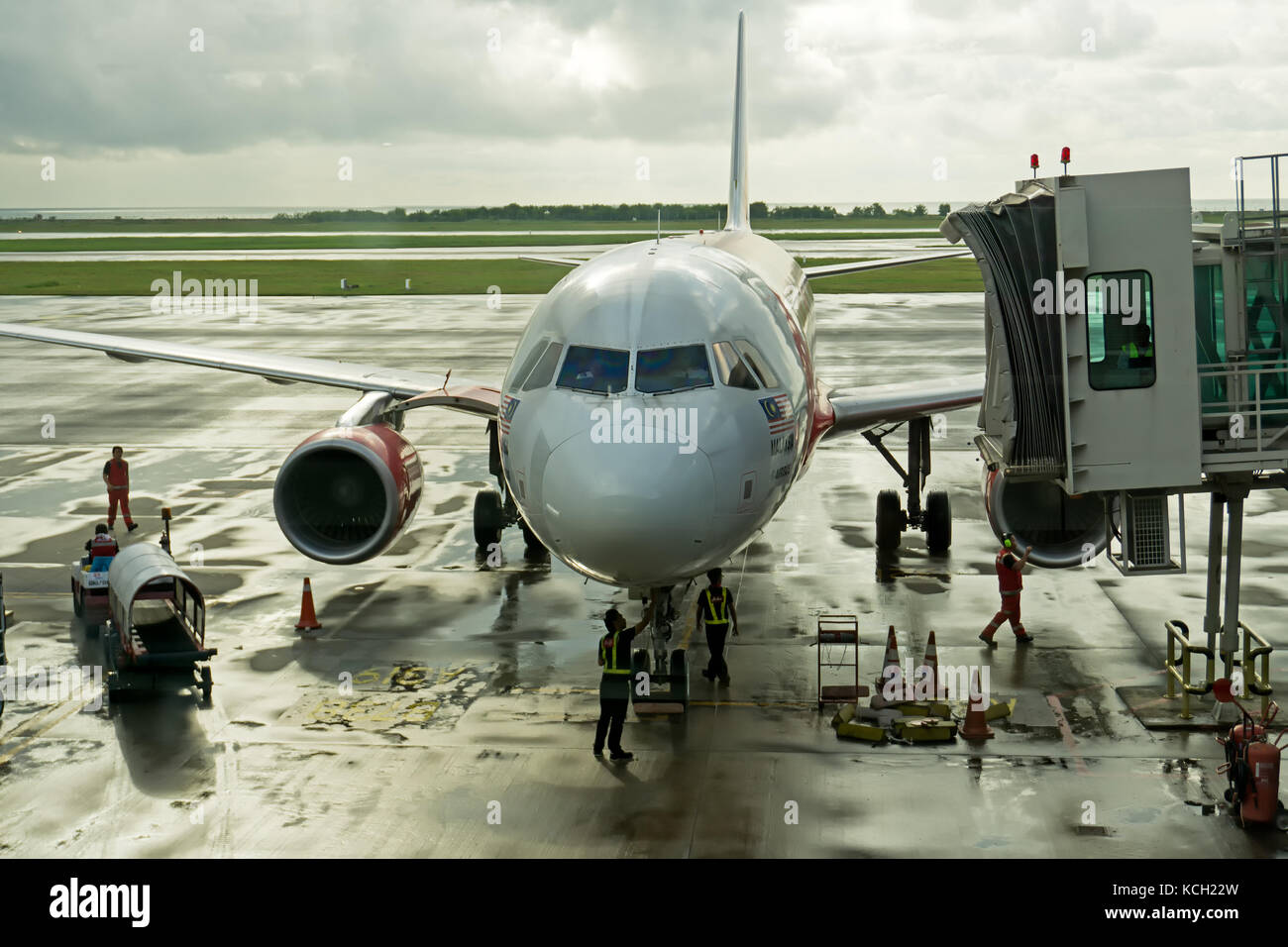 Kota Kinabalu, Malaysia - September 06, 2017: Technicians and mechanic doing a maintenance on airplane before the - Stock Image