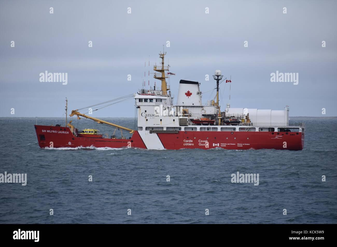 The Canadian Coast Guard Martha L. Black-class light icebreaker vessel CCGS Sir Wilfrid Laurier steams underway - Stock Image