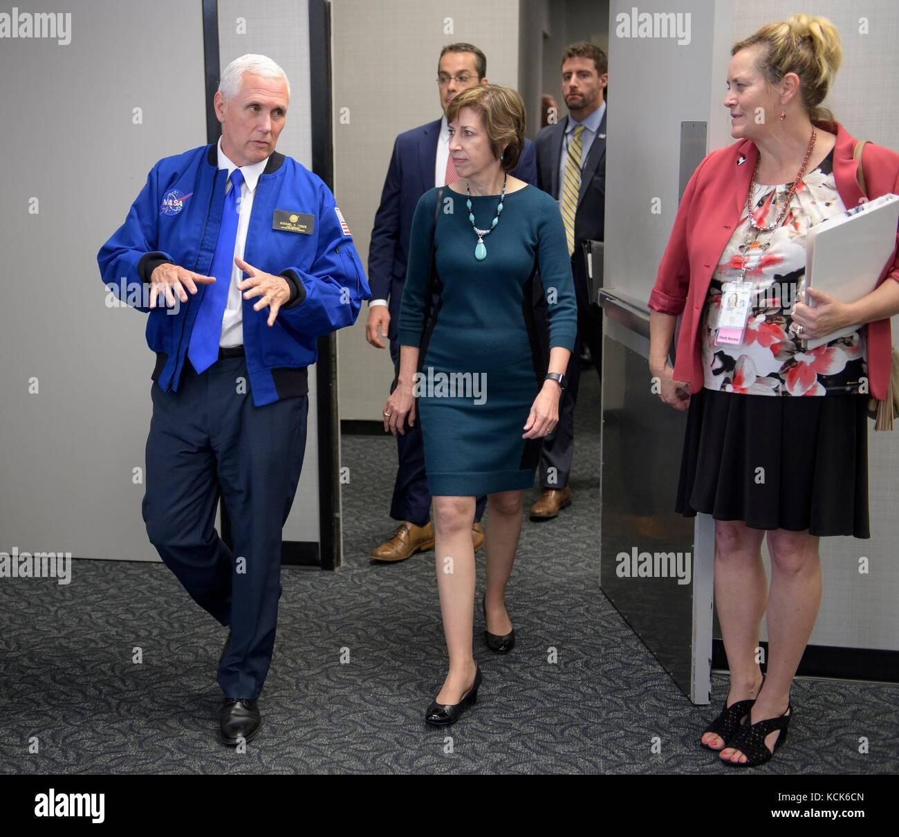 NASA Johnson Space Center Director Ellen Ochoa (right) gives U.S. Vice President Mike Pence a tour of the Johnson - Stock Image
