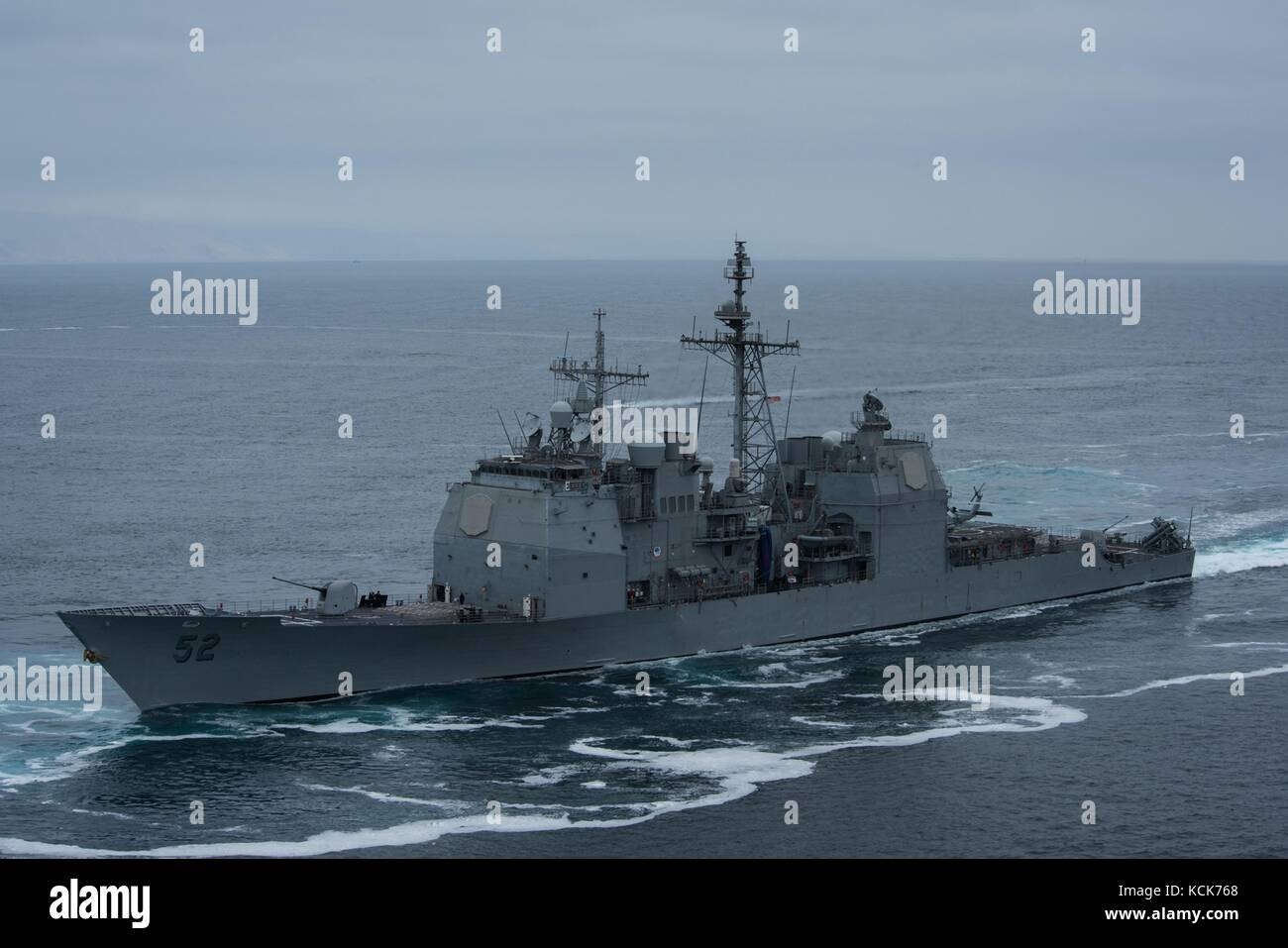 The U.S. Navy Ticonderoga-class guided-missile cruiser USS Bunker Hill steams underway during the Show of Force - Stock Image