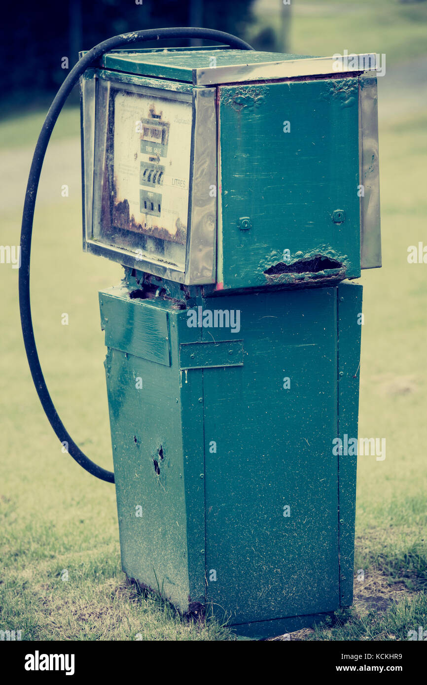 Rusty old petrol pump at an abandoned fuel station in Wester Ross, Scotland, UK - Stock Image