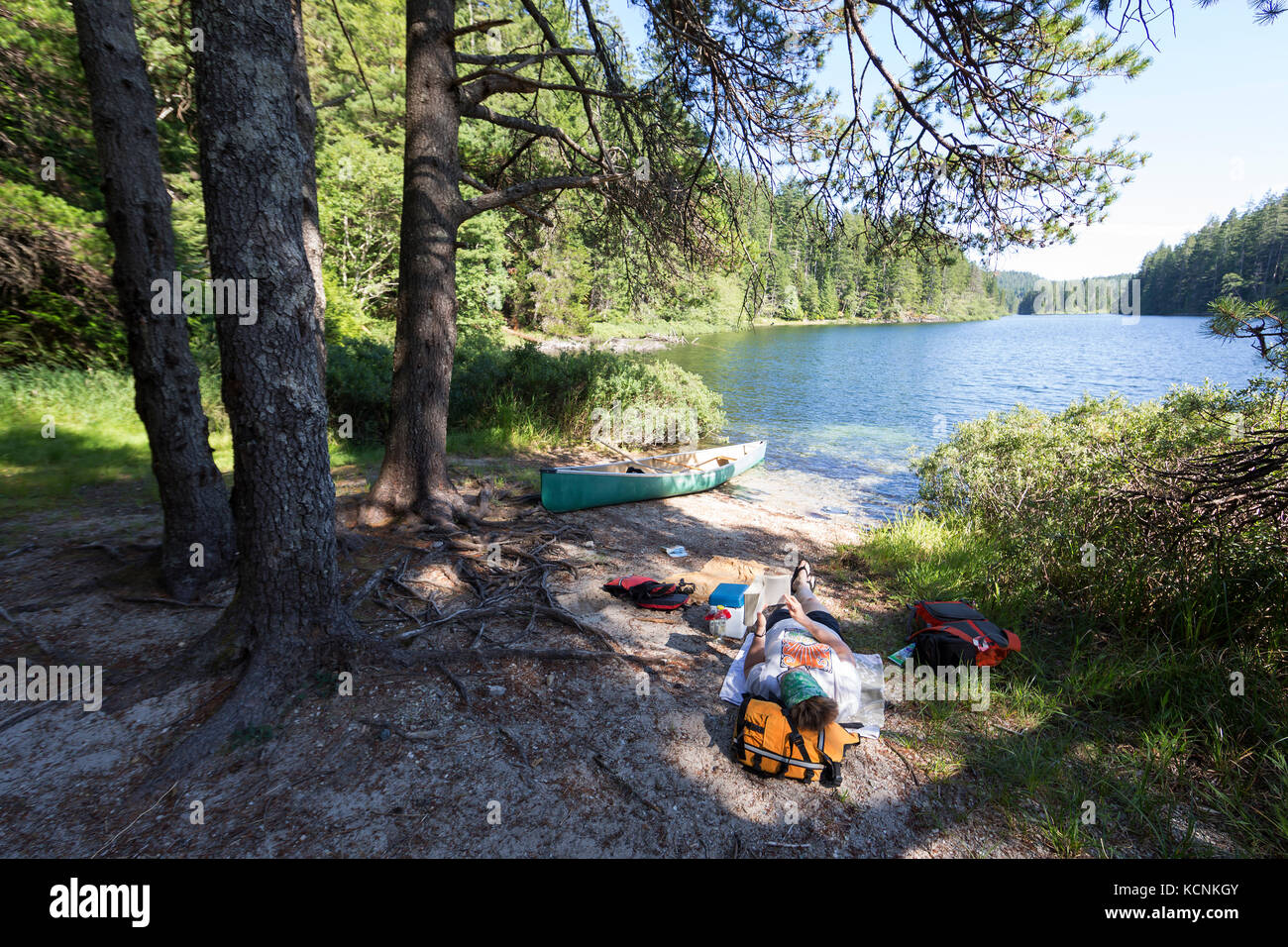 Relaxing while Canoeing on Village Bay Lakes on Quadra Island, British Columbia, Canada. - Stock Image