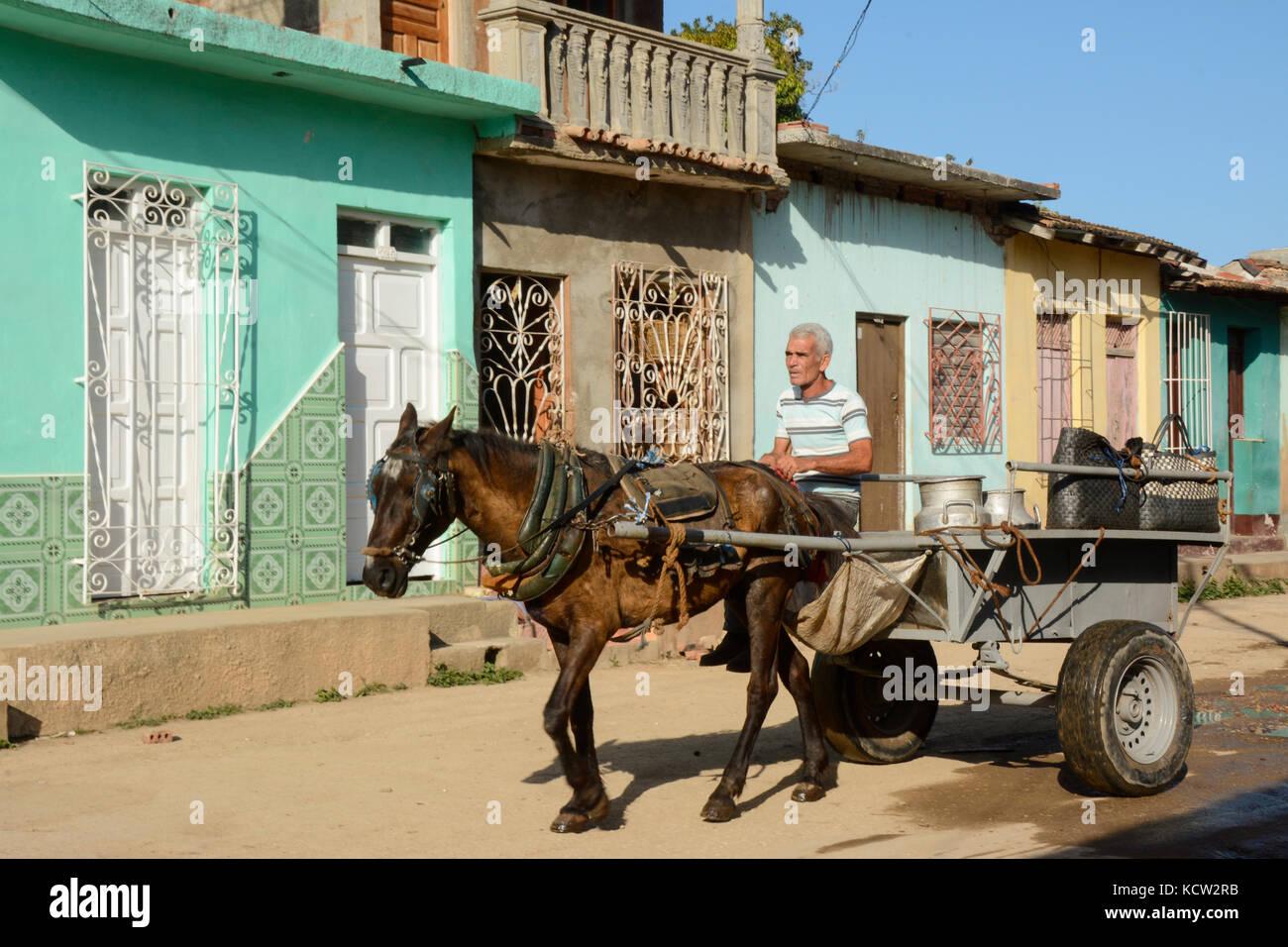 Delivering milk in a horse cart, Trinidad,  Cuba - Stock Image