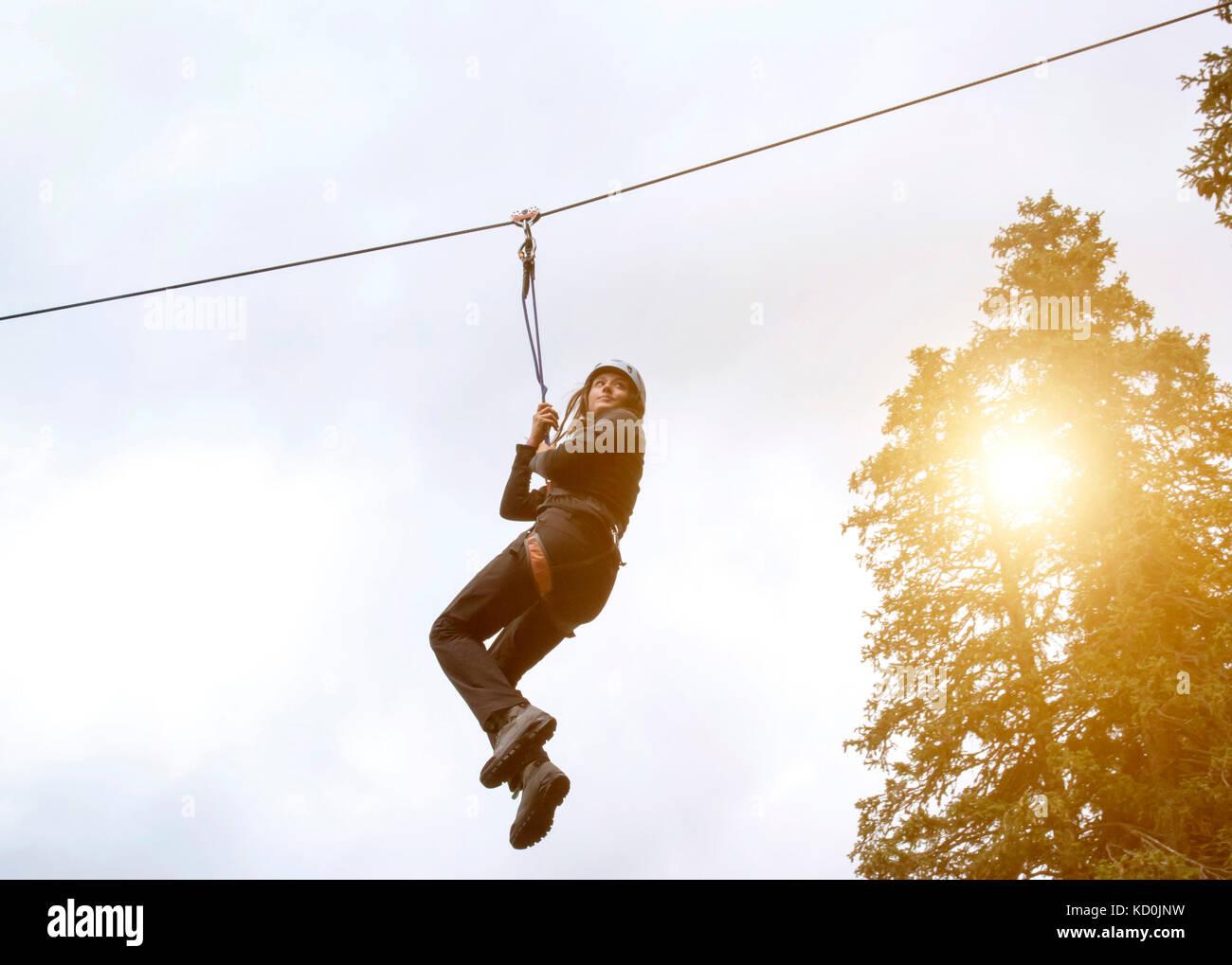 Teenage girl on zip wire - Stock Image