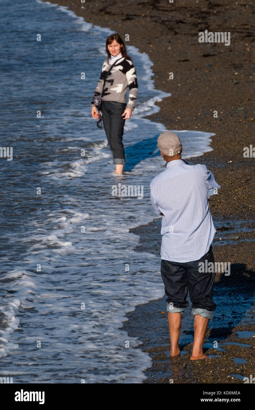 Aberystwyth Wales UK, Sunday 08 October 2017 UK Weather: People at the seaside in Aberystwyth Wales enjoying a wonderfully - Stock Image