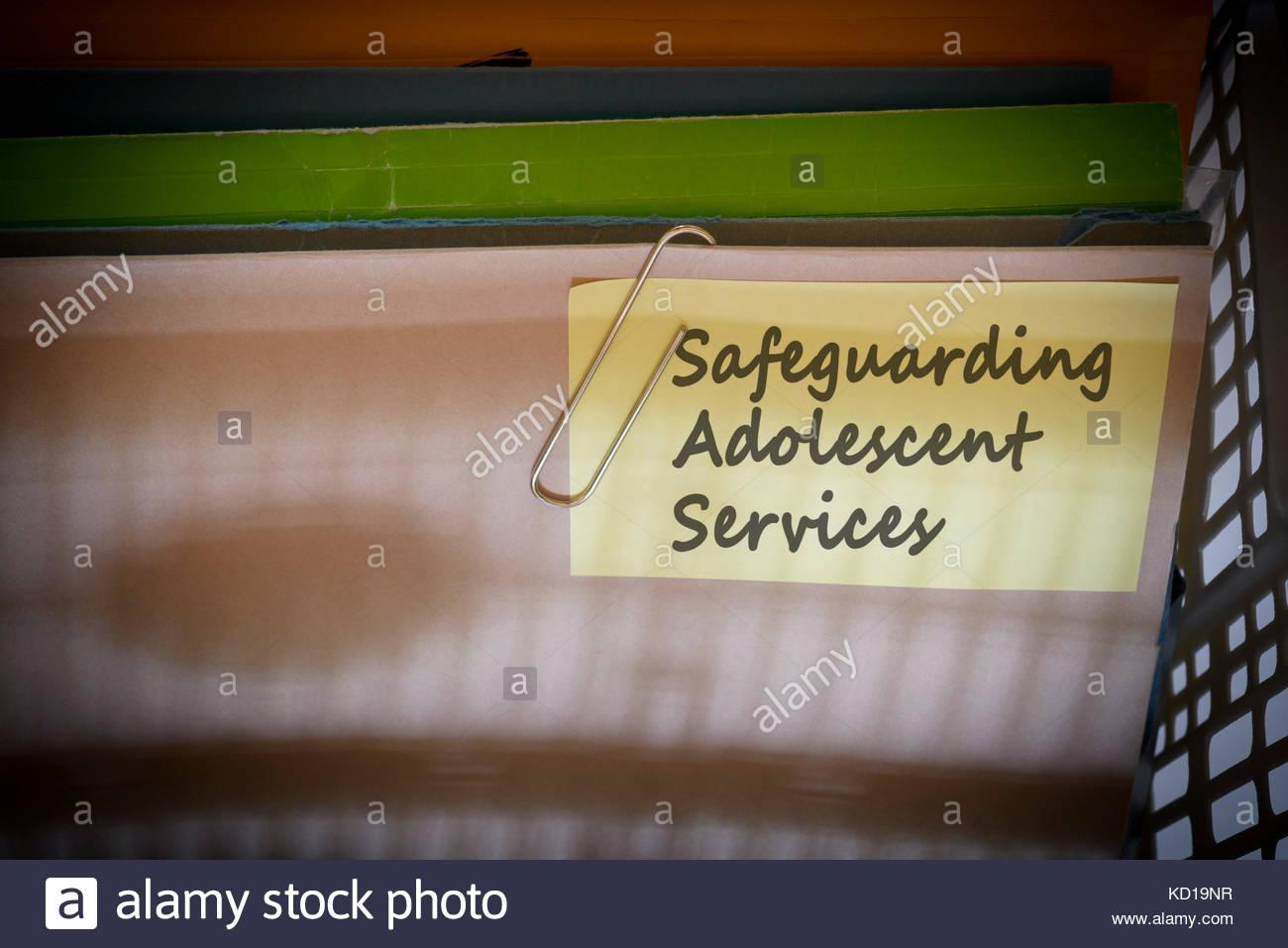 Safeguarding Adolescent Services written on document folder, Dorset, England. - Stock Image