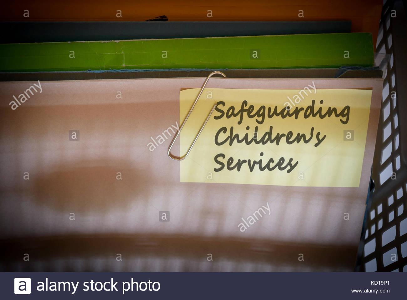 Safeguarding Children's Services written on document folder, Dorset, England. - Stock Image