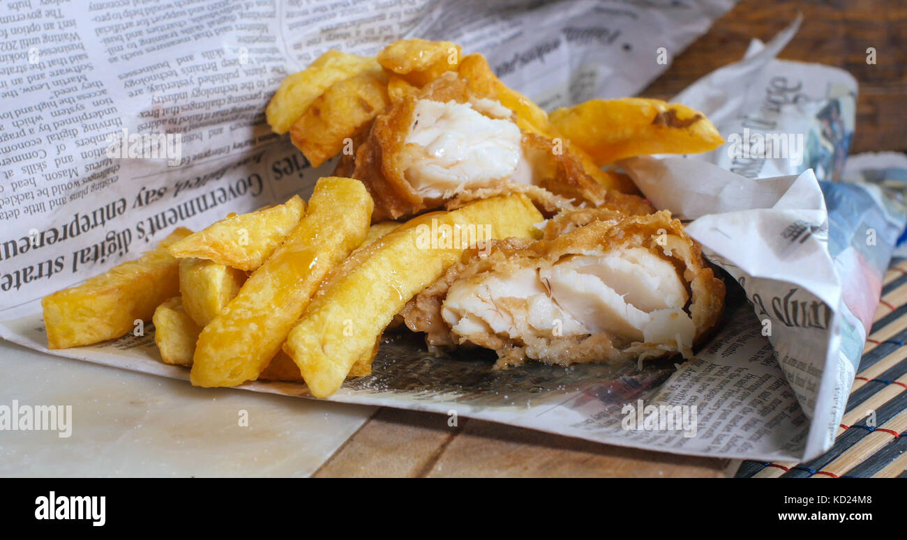 Chips in newspaper stock photos chips in newspaper stock for Fish and chips newspaper