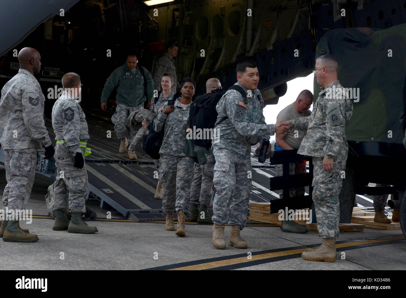 U.S. Army Brig. Gen. Brian C. Harris, the 167th Theater Sustainment Command Deputy Commander, greets troops of the - Stock Image