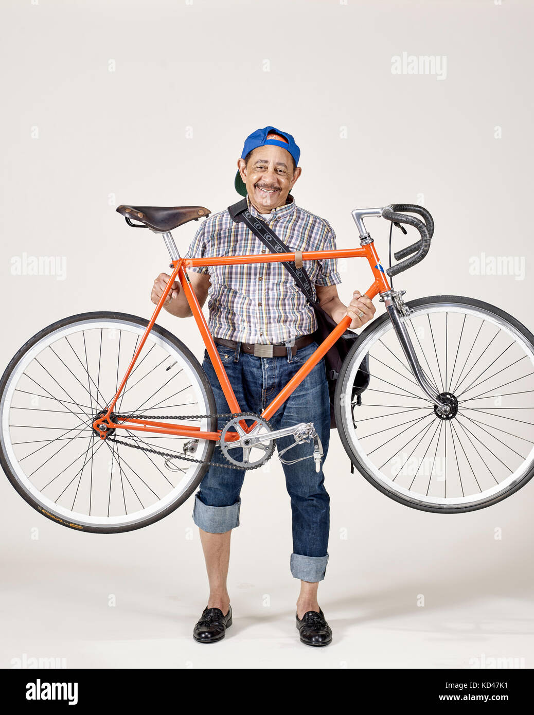 Senior Af-am man with bicycle studio portrait - Stock Image