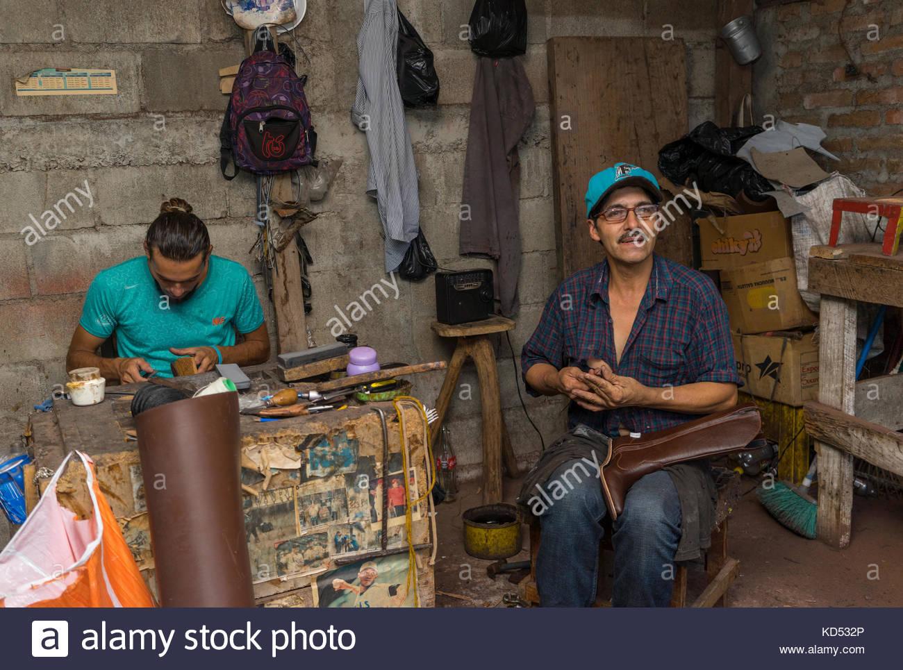 men-working-in-cobblers-shop-KD532P.jpg