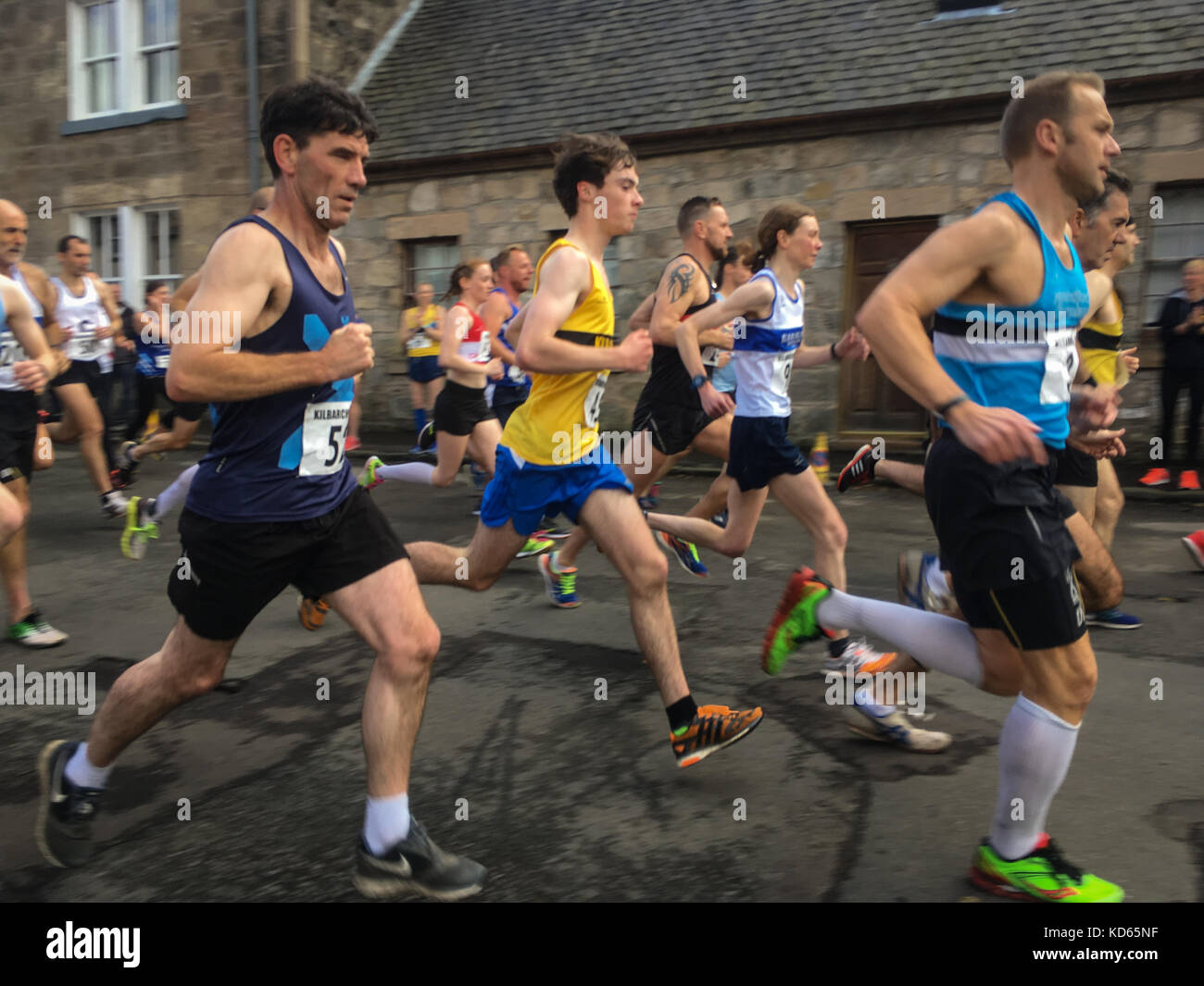 Competitors at the Kilbarchan Amateur Athletics Club George Cummings Road Relay, in Houston, in Scotland, on 7 October - Stock Image