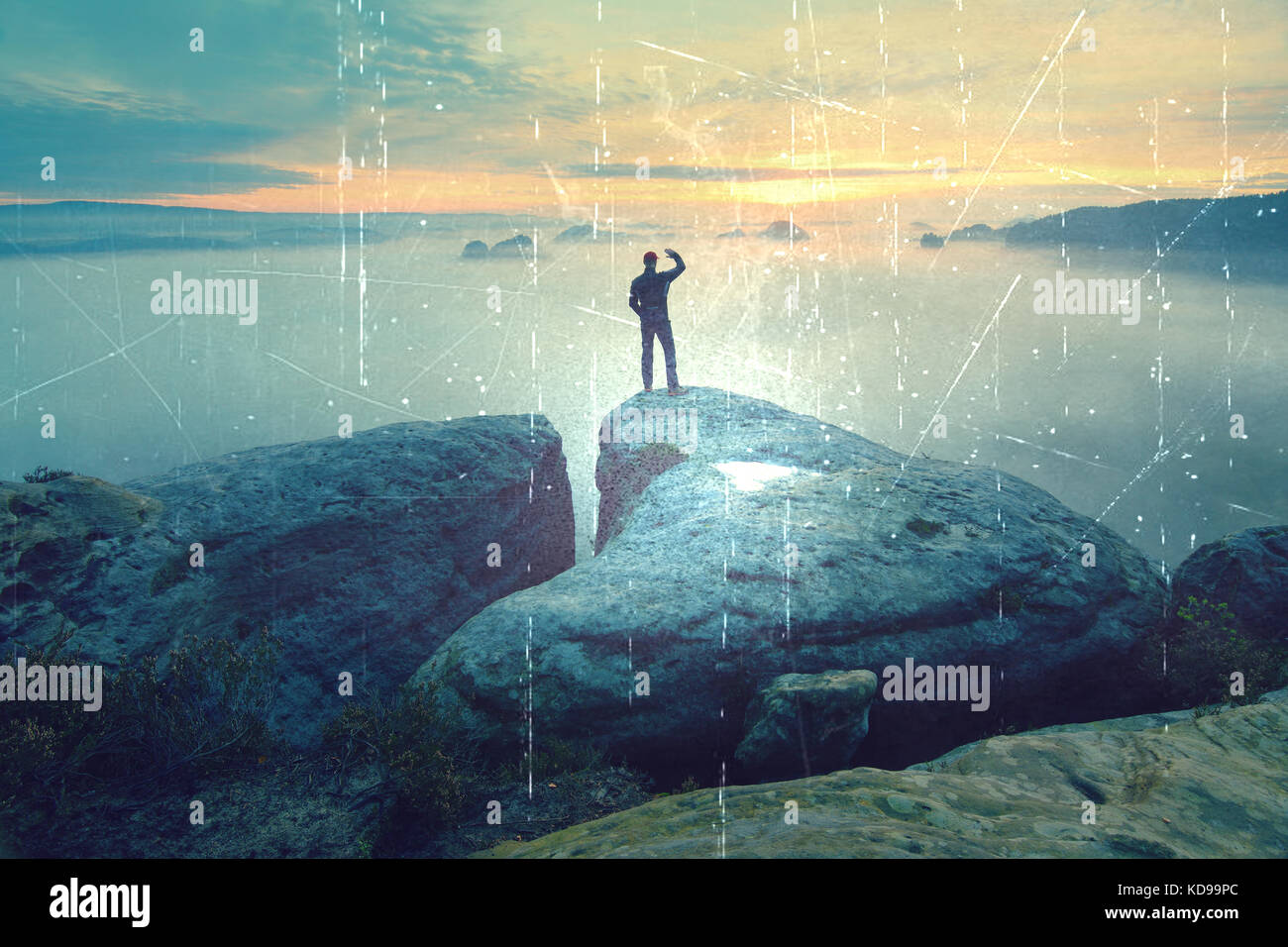 Lens defect. Sharp rear man silhouette on rocky peak. Satisfy hiker enjoy view. Tall man on rocky cliff watching - Stock Image