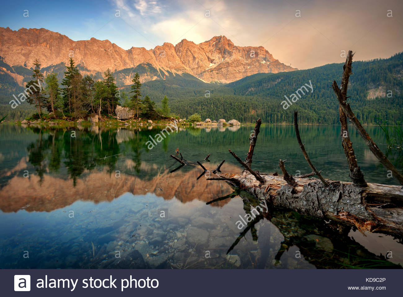 Sunset view at mountain peak Zugspitze. Summer day at lake Eibsee near Garmisch Partenkirchen. Bavaria, Germany - Stock Image