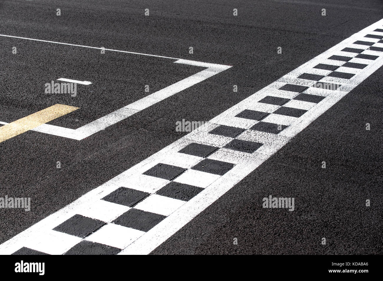 Checkered finish line and pole position sign in motor sport racing track  concept of top number one first position, - Stock Image