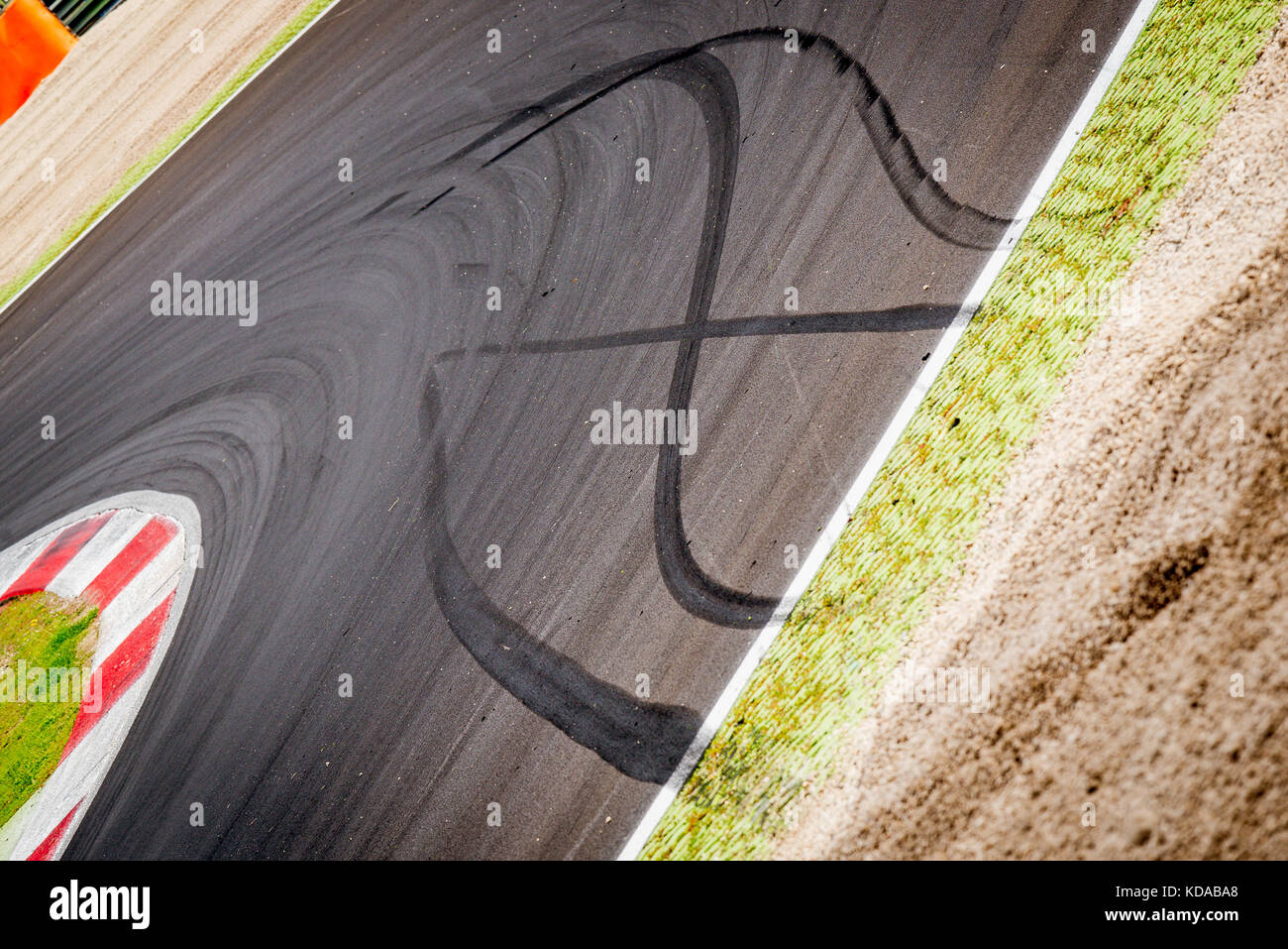 Motor sport racing track round with car slammed brakes black signs concept of stay in instead going out of track - Stock Image