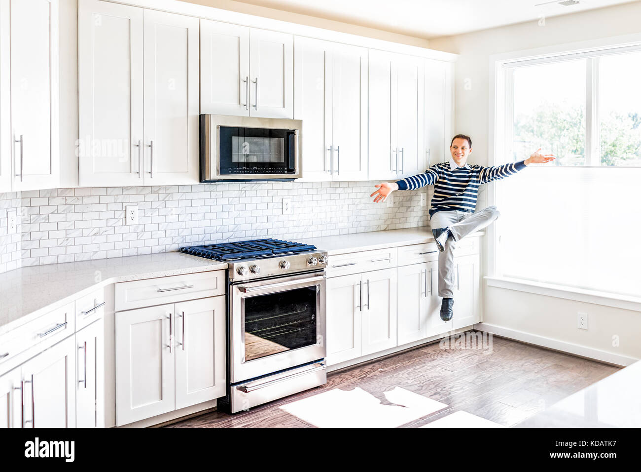 Microwave oven man stock photos microwave oven man stock for Oven cleaner on kitchen countertops
