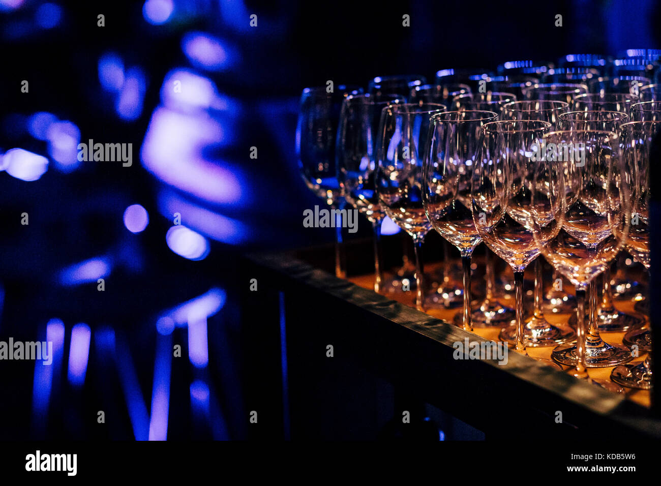 Luxury table settings for fine dining with and glassware, beautiful blurred  background. Preparation for holiday - Stock Image