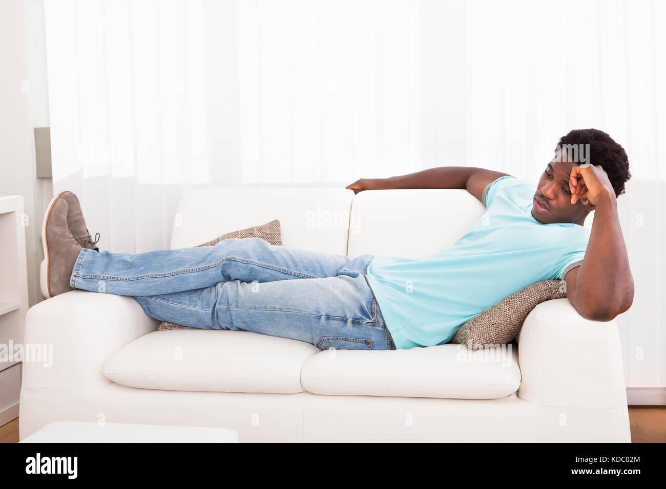 lazy man stock photos lazy man stock images alamy. Black Bedroom Furniture Sets. Home Design Ideas