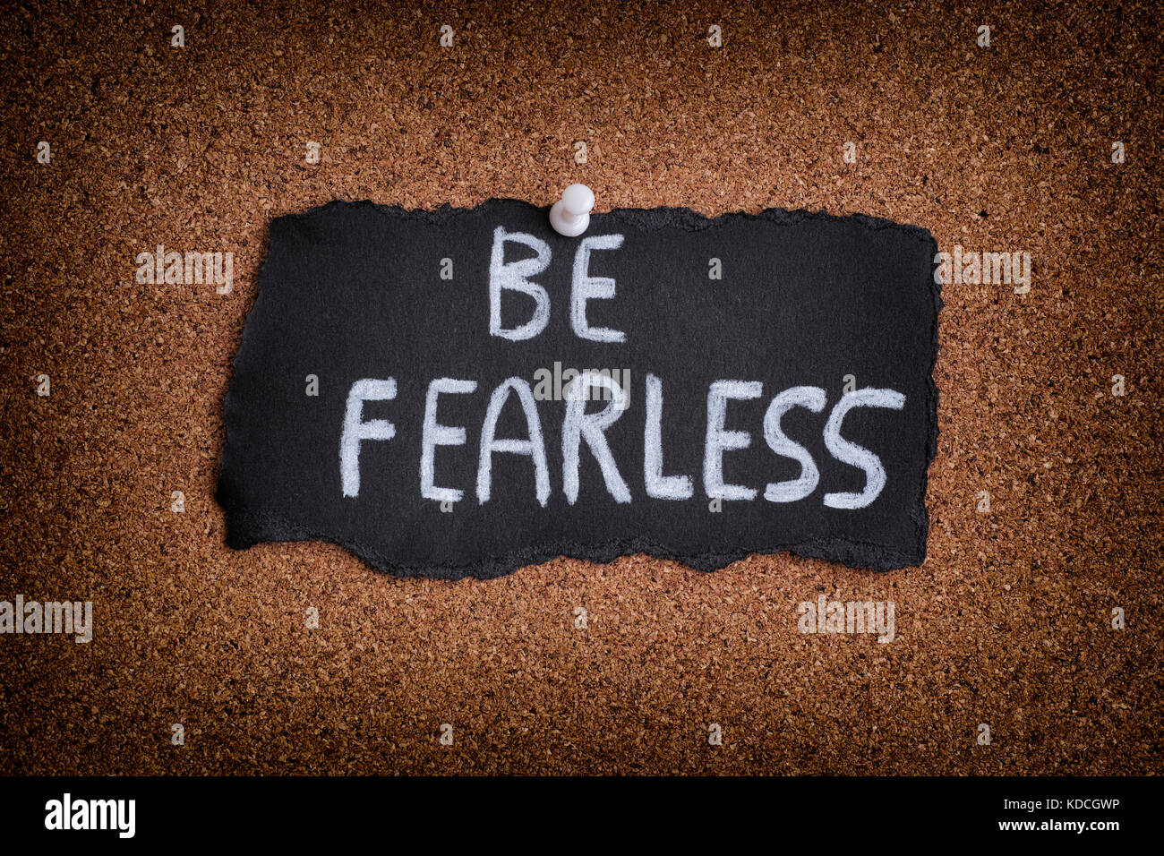 Be Fearless. Piece of black paper with phrase Be Fearless. Close up. - Stock Image