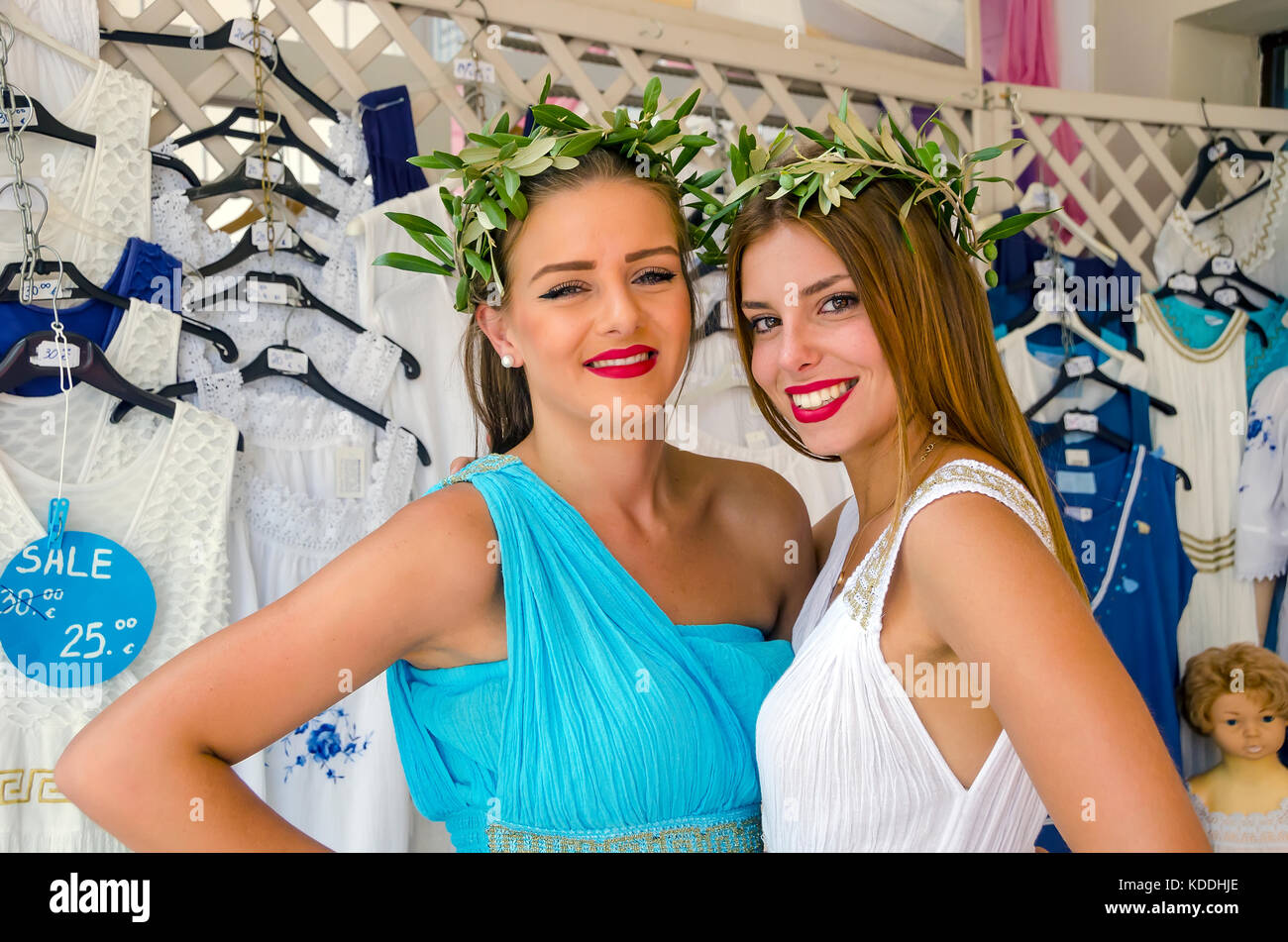 Sales women in clothing store wearing classical Greek dresses Argostoli, Kefalonia, cephalonia, Ionian Islands, - Stock Image
