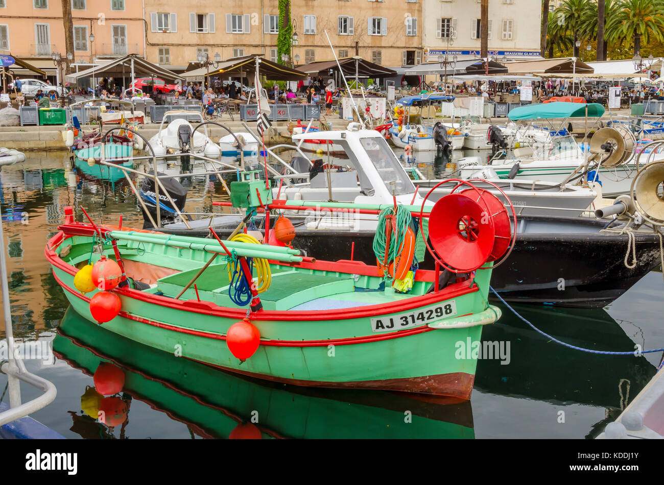 Green and red fishing boat in the habor marina, Ajaccio, Corsica, France. - Stock Image