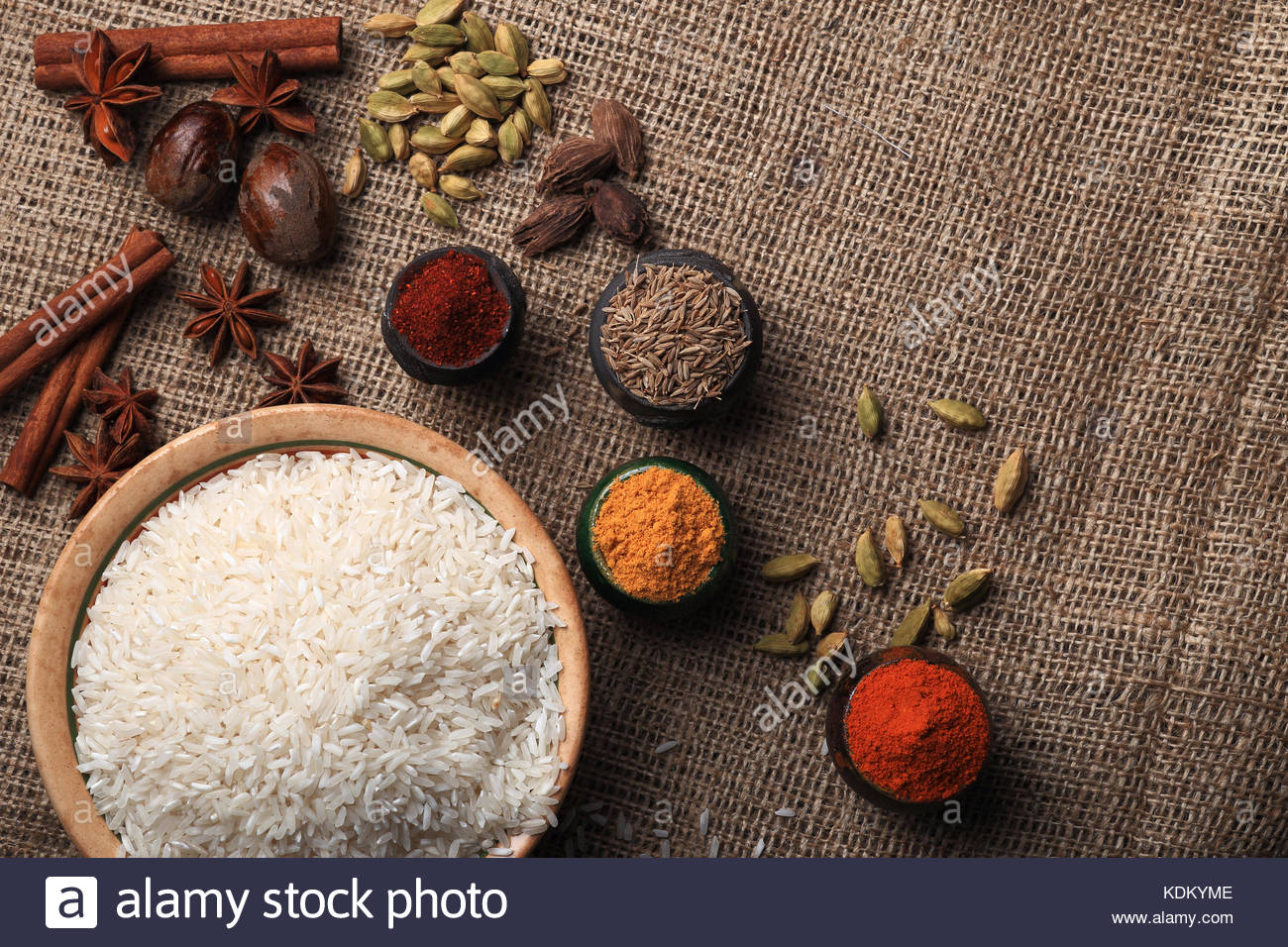 Rice and assorted spices on the table basic raw for asian for 7 spices asian cuisine