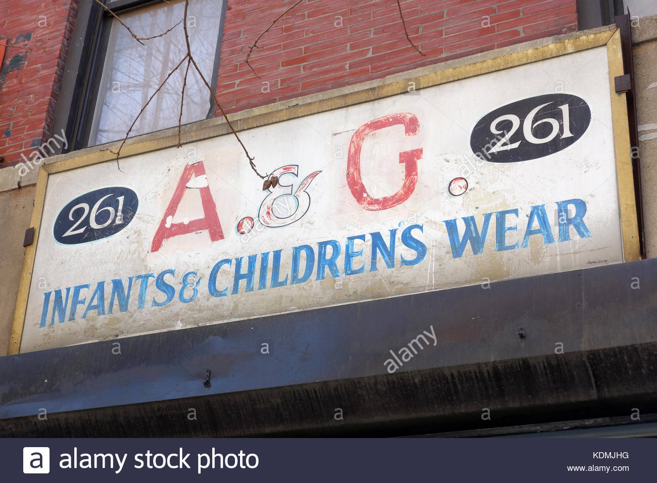 A & G Infants & Children's Wear Ghost Sign - Stock Image