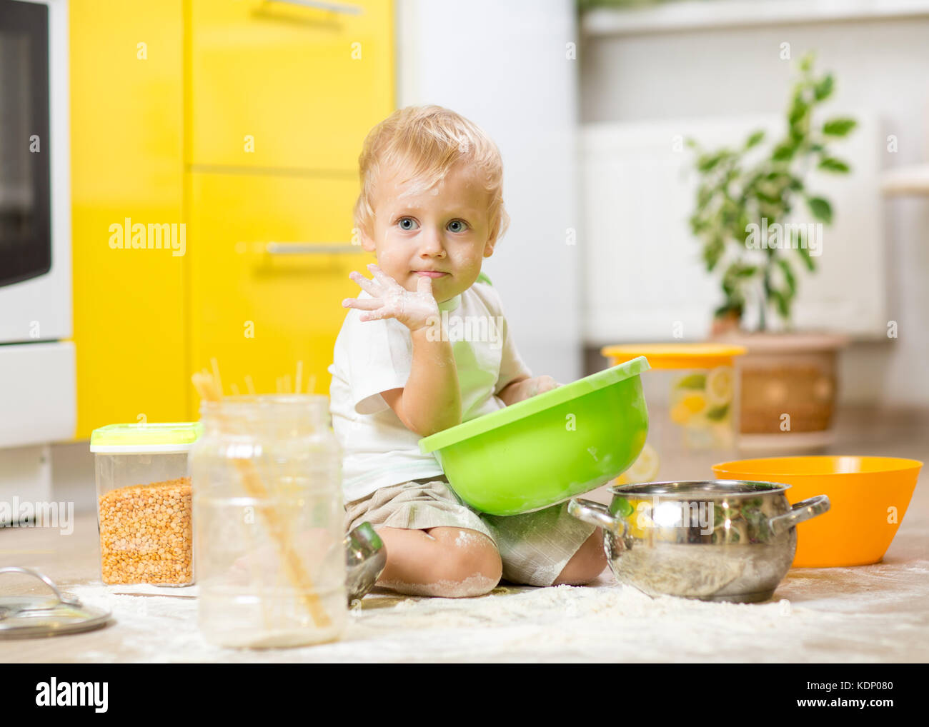 Child Playing On Kitchen Floor