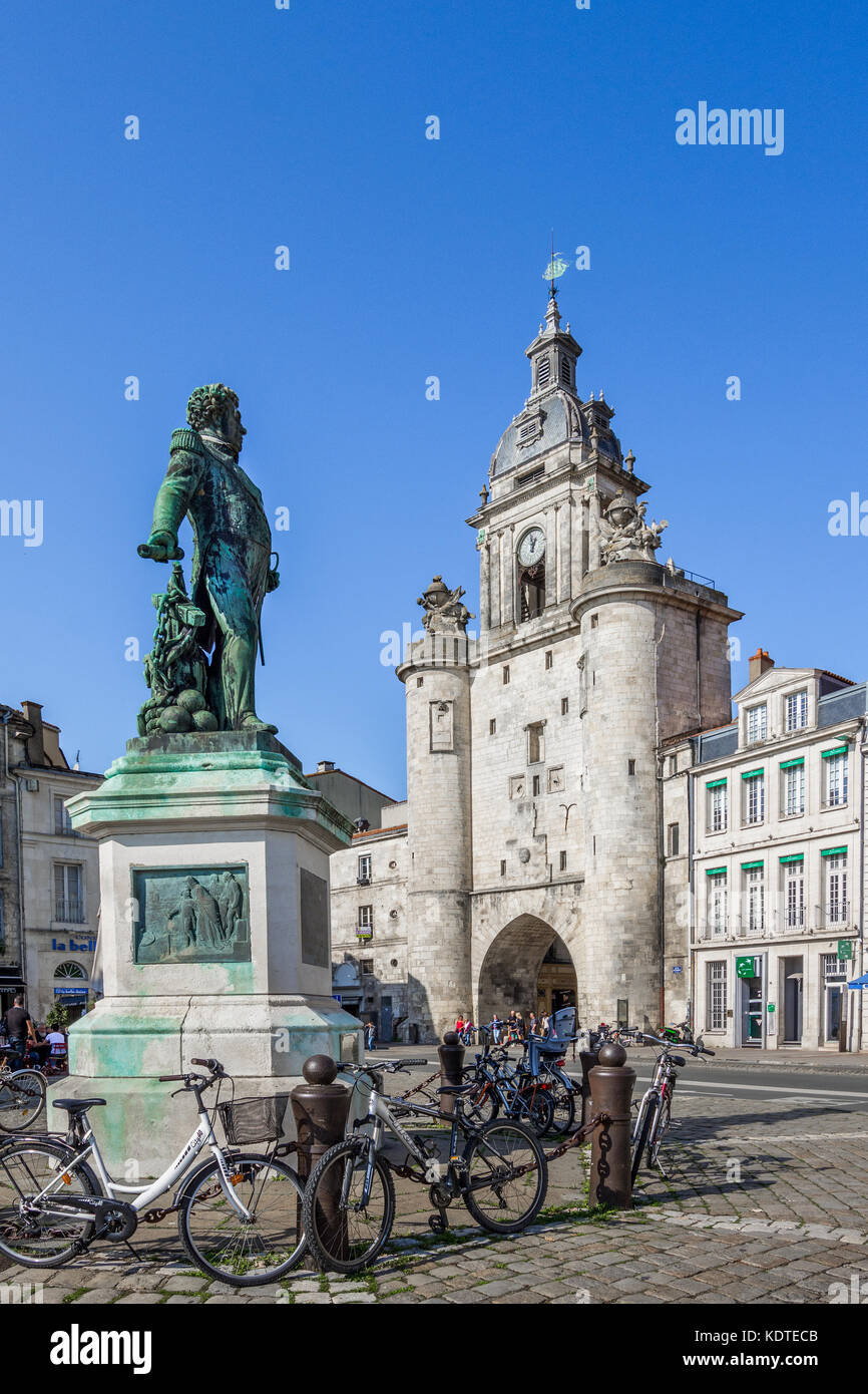 Statue of Admiral Duperré and the Great Clock (La Grosse Horloge) La Rochelle, Charente-Maritime, France. - Stock Image