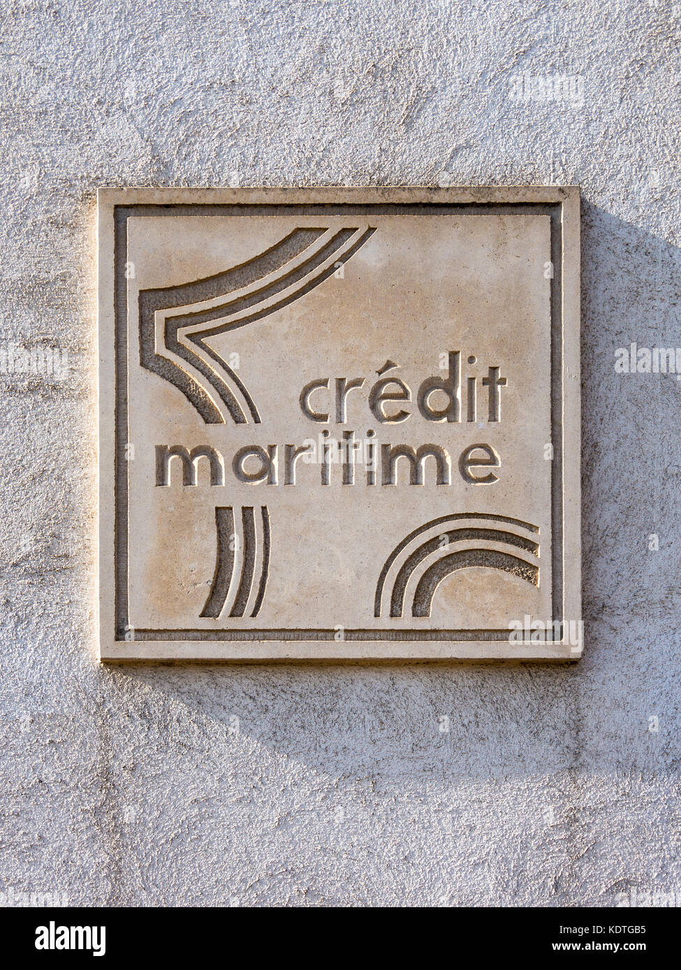 Credit Maritime stone plaque, La Rochelle, France. - Stock Image