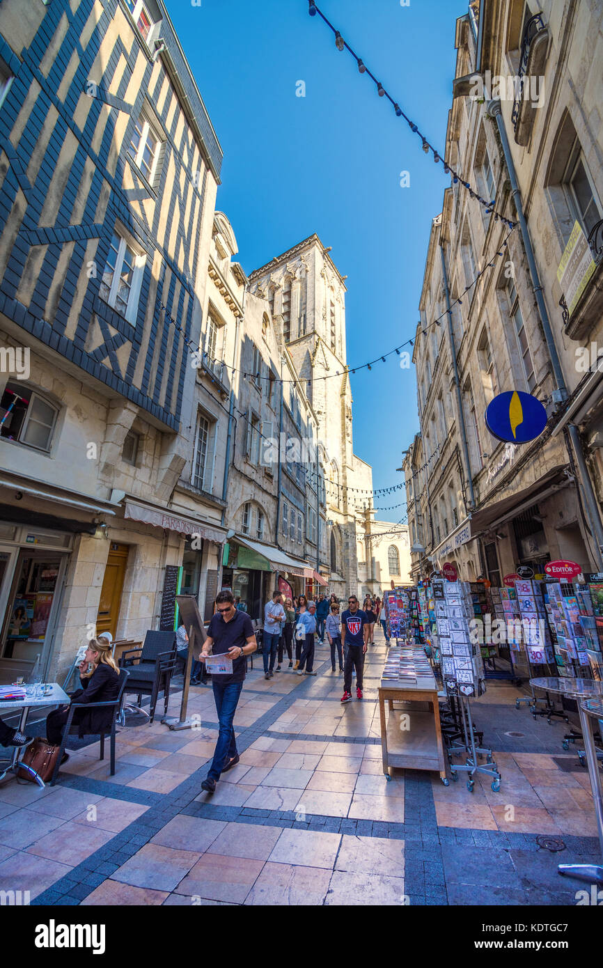 Paved walking area between shops in old town of La Rochelle, France. - Stock Image
