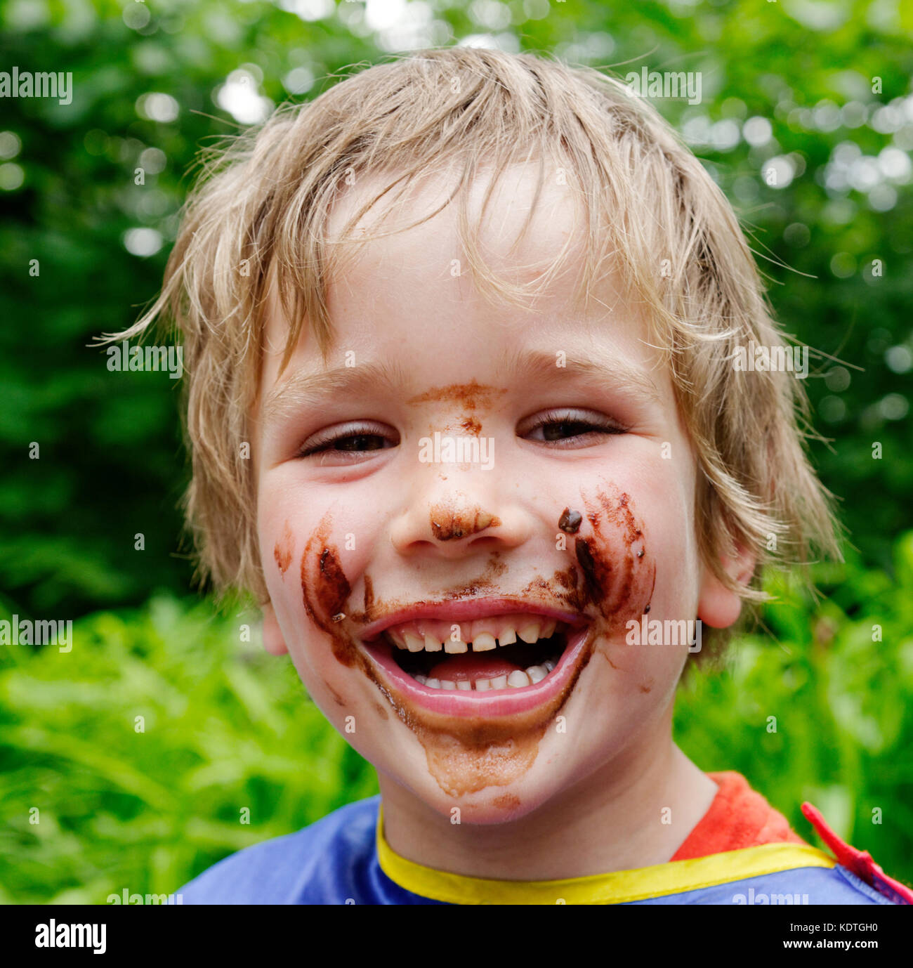 a-little-boy-5-yrs-old-laughing-with-his-face-covered-in-chocolate-KDTGH0.jpg