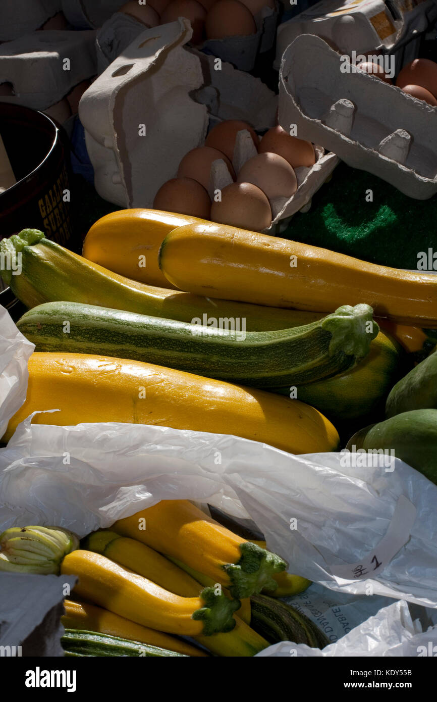 Cougettes, marrows and eggs on a Suffolk market stall - Stock Image