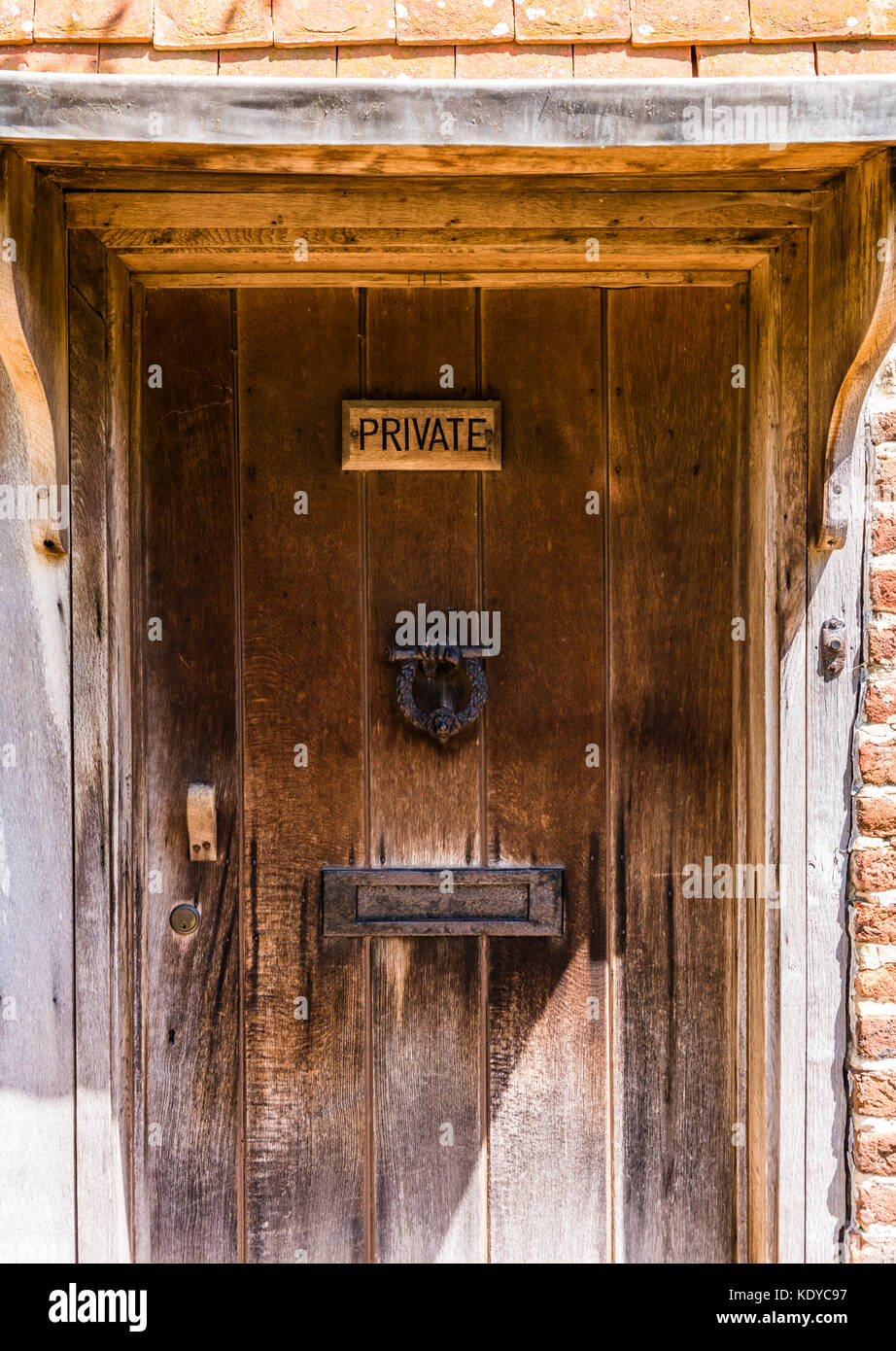 Private wooden door at Sissinghurst Gardens, Kent, UK - Stock Image