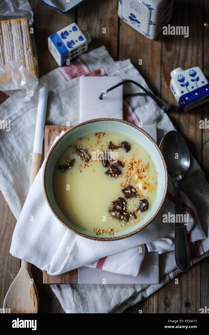 Soup parmentier. Potato and leek with fried mushrooms - Stock Image