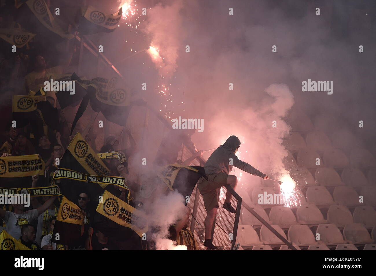 Nicosia, Cyprus. 17th Oct, 2017. Dortmund fans light fireworks in the stands during the Champions League group stages - Stock Image