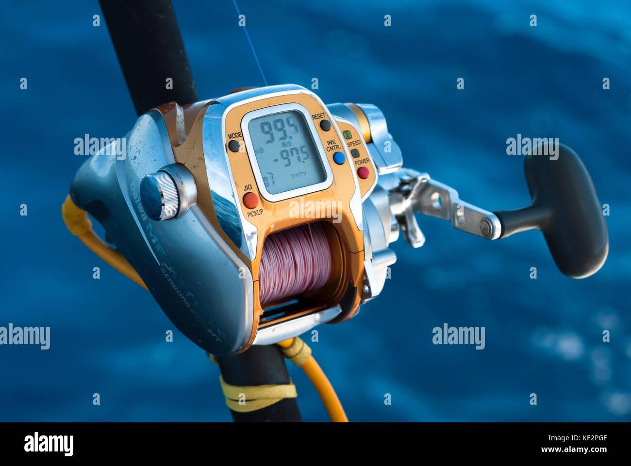 A Daiwa electric fishing reel - Stock Image