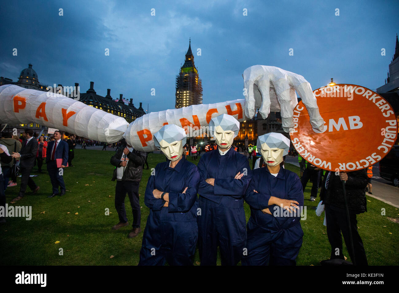 People from the GMB union, dressed as Theresa May, known as 'Maybots', protest at Parliament square at the - Stock Image