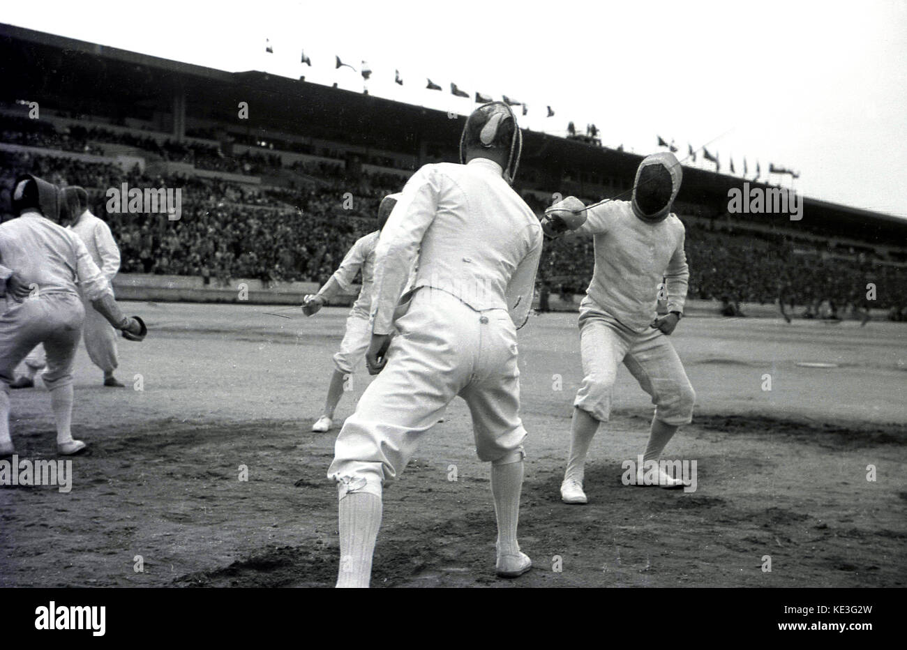 1938. historical, male competitiors fencing in the centre of the giant Strahov Stadium, Prague, Czechoslovakia at - Stock Image