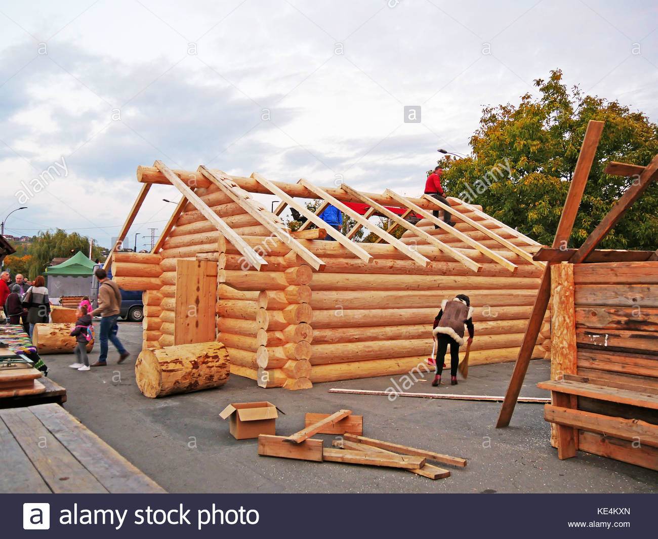 Timber framing worker stock photos timber framing worker for Log cabin roof construction