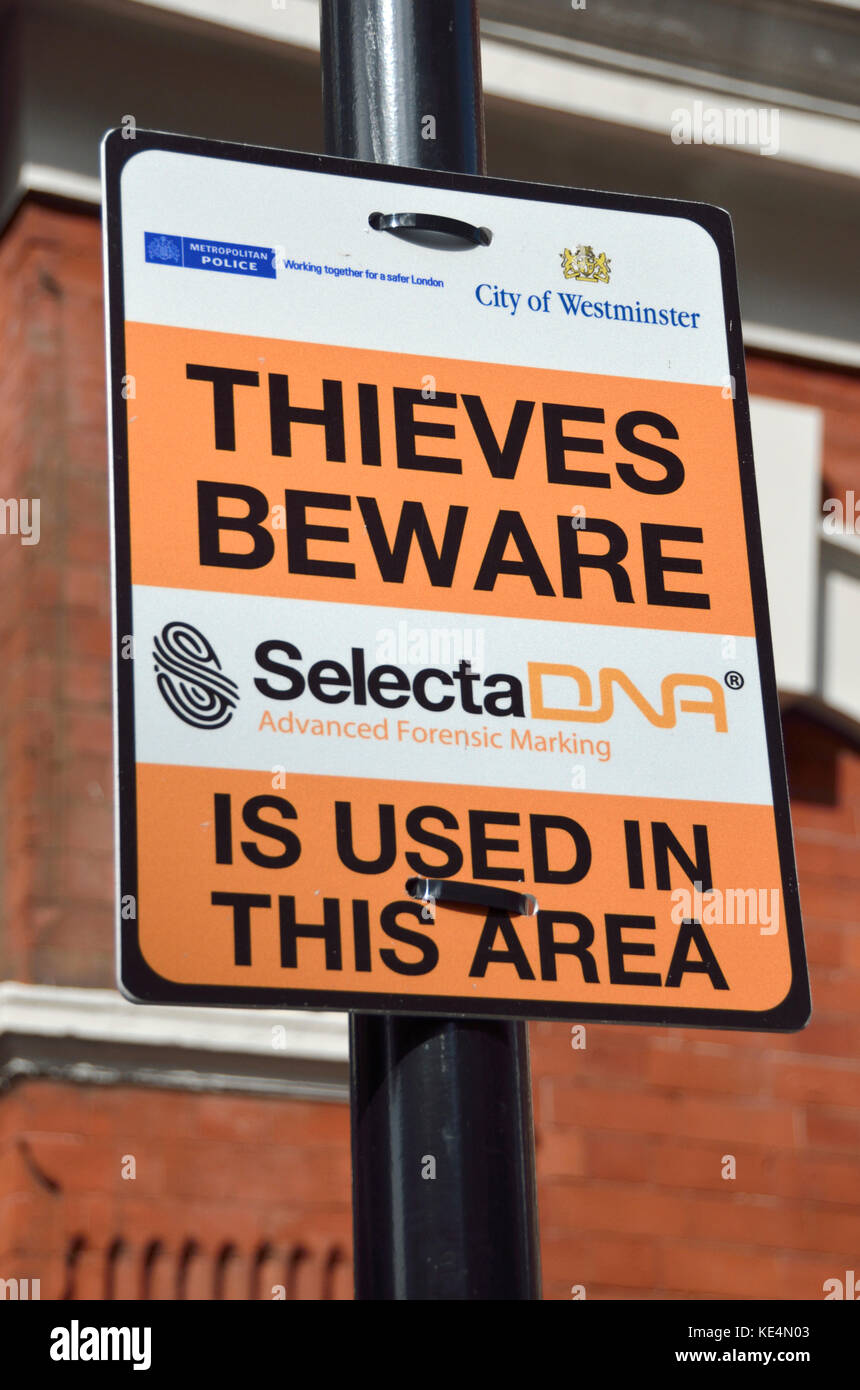 'Thieves beware SelectaDNA used in this area' warning sign in a London street. - Stock Image